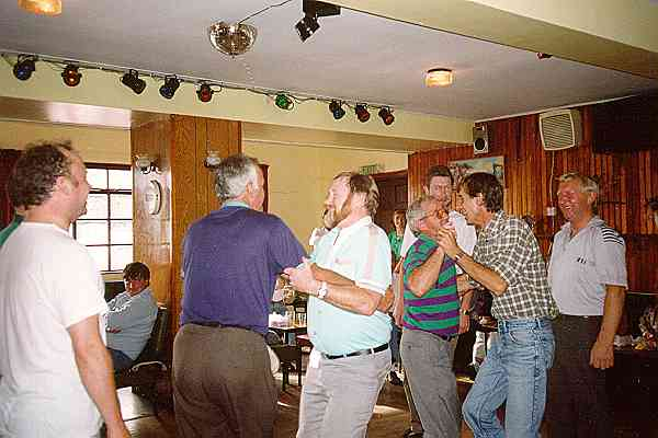 Connie Ryan dance master, acting the eejit and dancing a buck set - all men and all smiling. Image Set Dancing News